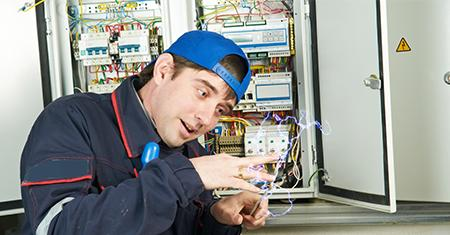 man getting shocked from fuse box