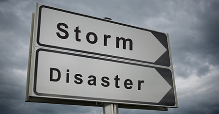 storm disaster road sign